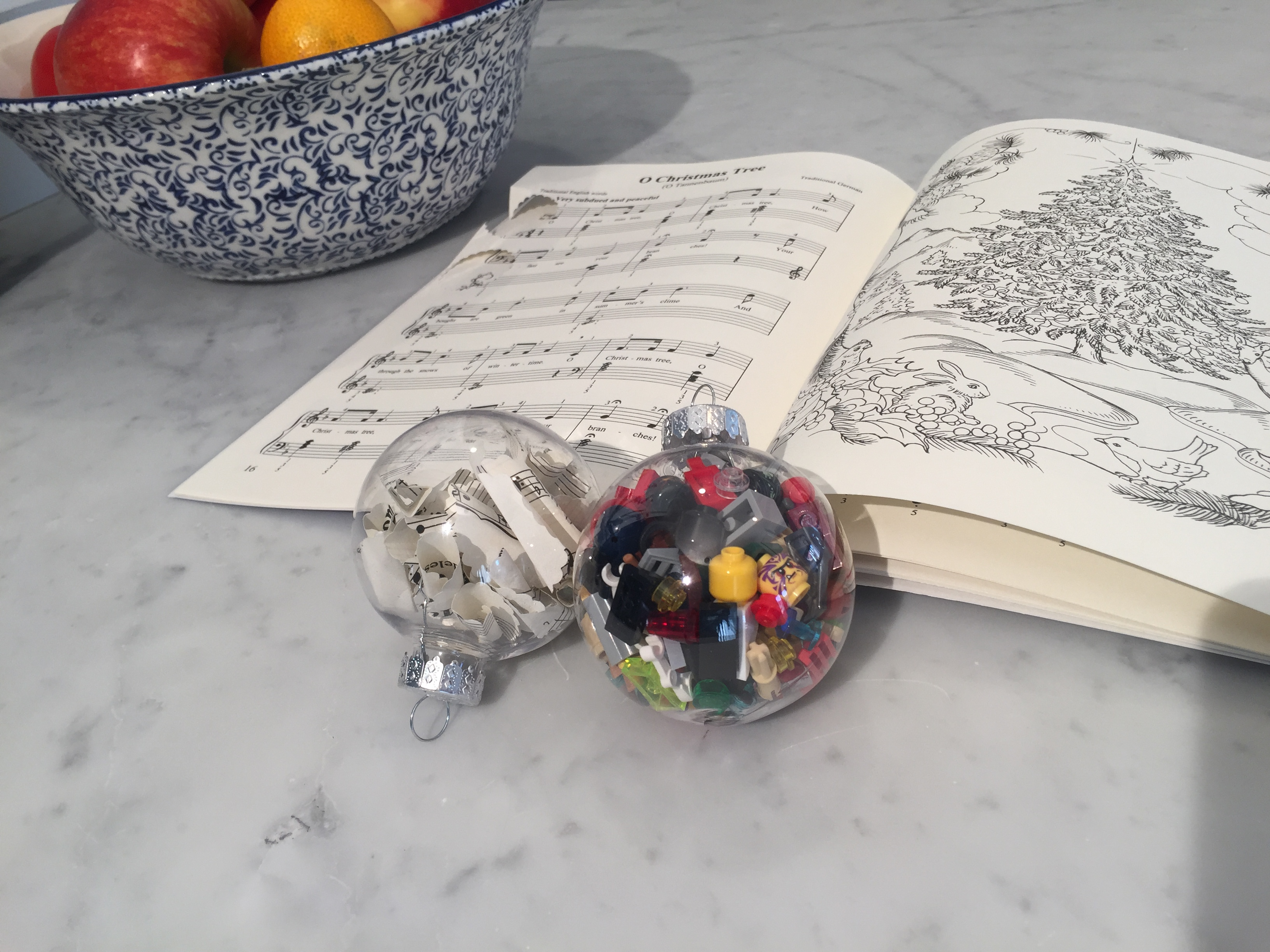 DIY Christmas Ornaments Filled with Sheet Music and Legos